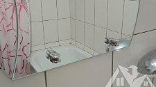 Навесить зеркало в ванной комнате