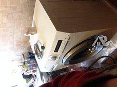 Установить отдельно стоящую стиральную машину AEG на кухне