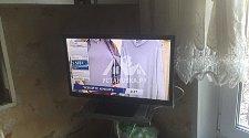 Установить телевизор на подставку и настроить каналы